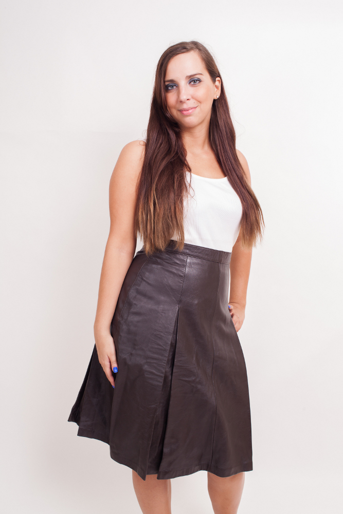 Women's Lambskin Leather Skirt with Pleats (Knee Length)  Black-Small Black- Medium Black-Large      Women's lambskin leather skirt with pleats in front and back. The leather skirt is knee length.t. A very elegant skirt suitable for wearing at parties or outdoors. 100% nylon lining inside. Imported